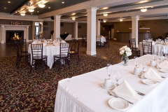 Banquet-room-with-white-place-settings
