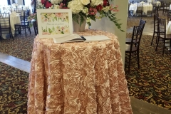 Blush-floral-table-cloth-with-guest-book-atop
