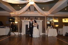 Bride-and-groom-walking-in-recption-room-together