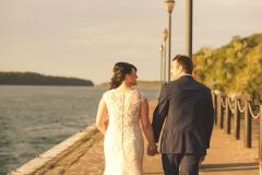 Bridge-and-groom-hold-hands-walking-away