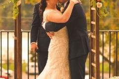 Bridge-and-groom-kissing-at-the-altar