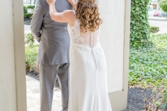 Bridge-touching-the-shoulders-of-the-groom