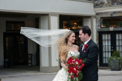 Bridge-with-red-bouquet-with-groom-outside-of-Niagara-Crossing-Hotel-and-Spa