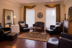 Reception-room-with-brown-leather-seating