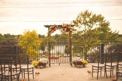 Wedding-arch-with-seating-down-the-aisle