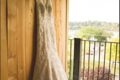 Wedding-dress-on-hanger-on-the-patio