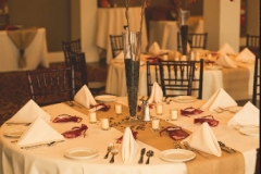 Wedding-table-place-setting-with-red-accents