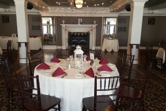 Wedding-table-setting-with-red-napkins-and-string-lights-above