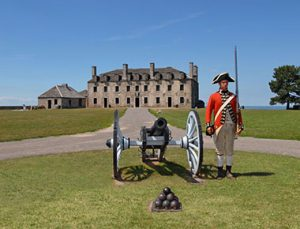 old fort niagara with solider and cannon afront
