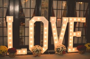 Lighted LOVE sign with flowers around