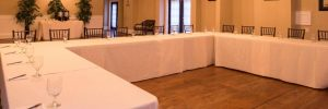 U shaped table with chairs and white table cloth