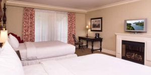 Elegant Non-Smoking Double Queen Room with TV, fireplace, and work desk