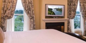 side angle Royal Riverview King with water view and flat screen TV