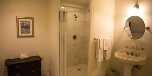 bathroom of Royal Riverview King Room with standing shower and vanity